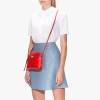 Coccinelle Leather mini clutch