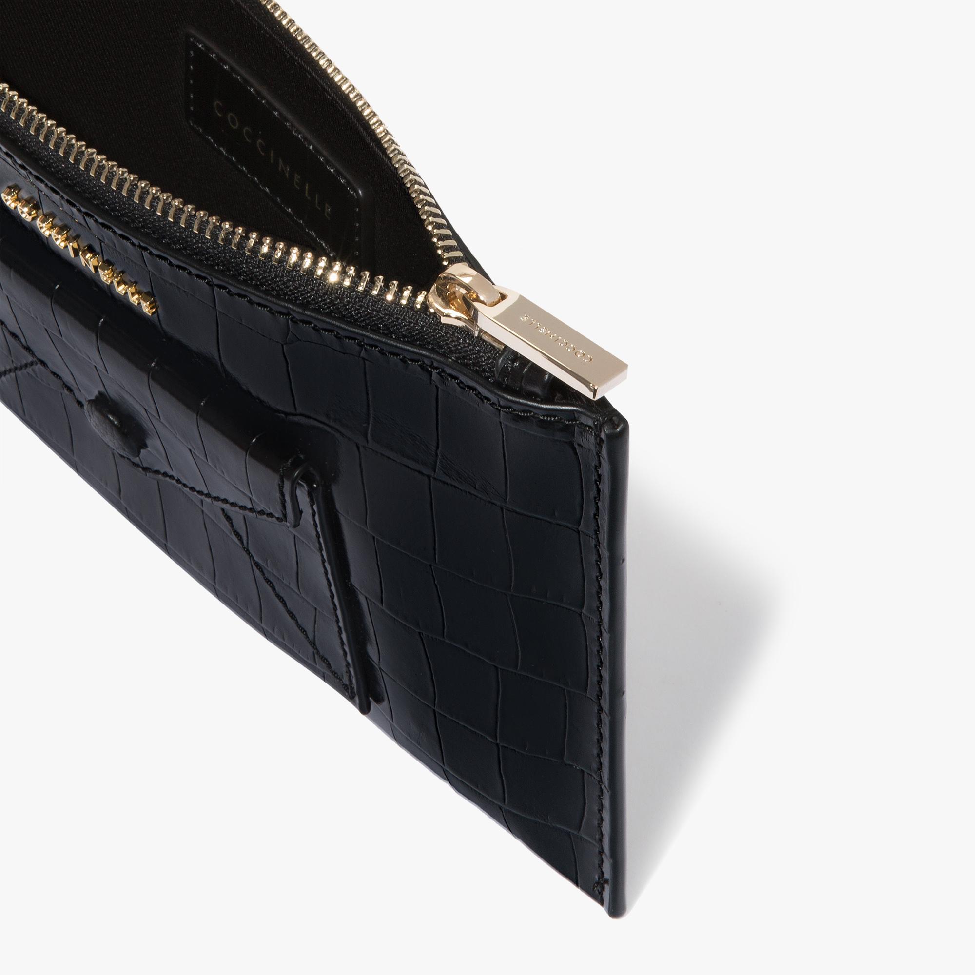 Crocodile-print leather clutch