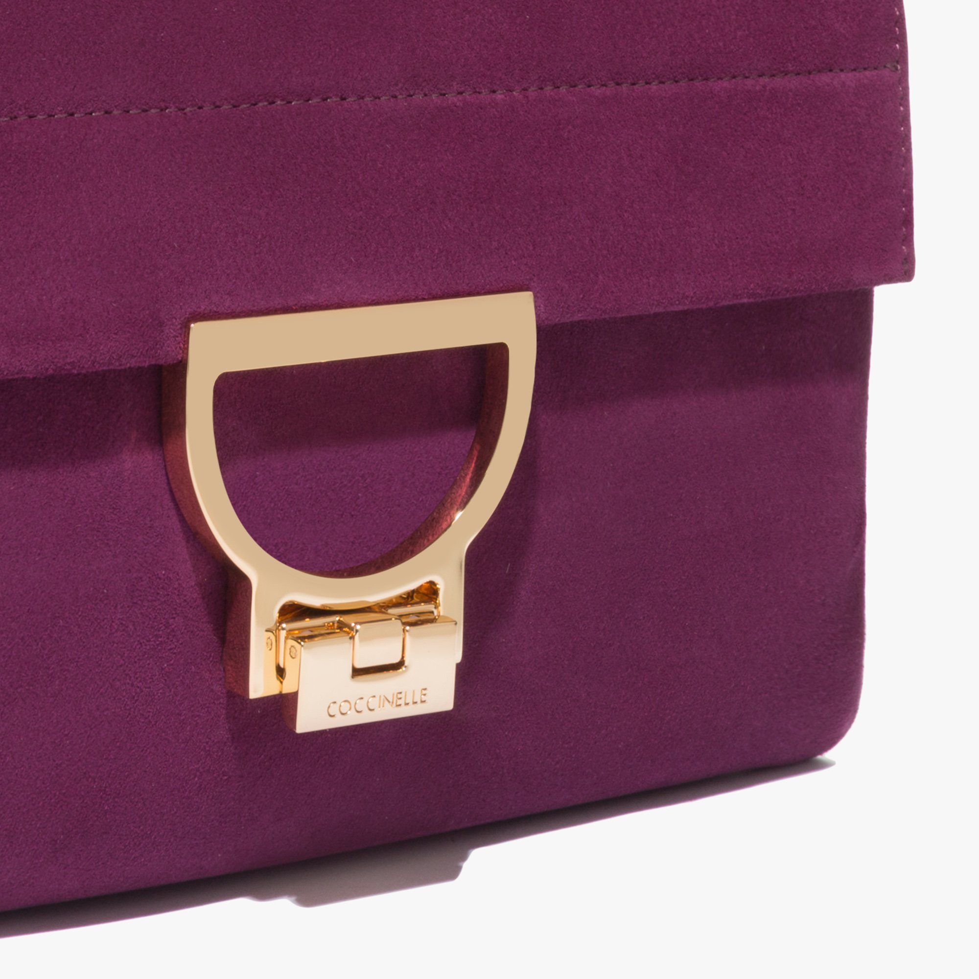 Coccinelle Arlettis suede bag with a single strap